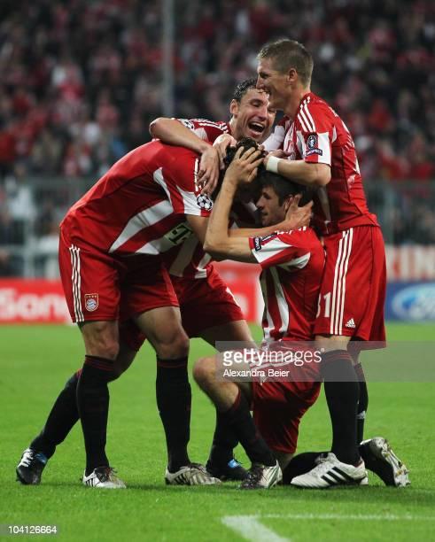 Mark van Bommel Daniel van Buyten Bastian Schweinsteiger and Thomas Mueller of Bayern celebrate Mueller's first goal during the UEFA Champions League...
