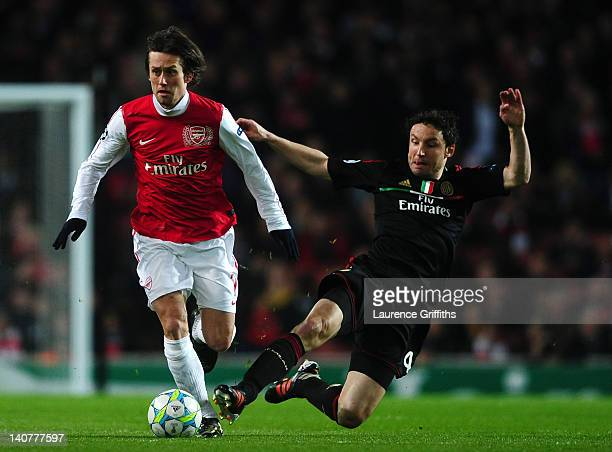 Mark van Bommel of AC Milan goes in for the tackle on Tomas Rosicky of Arsenal during the UEFA Champions League Round of 16 second leg match between...