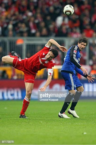 Mark van Bommel of Bayern and Marcus Berg of Hamburg jump for a header during the Bundesliga match between FC Bayern Muenchen and Hamburger SV at...