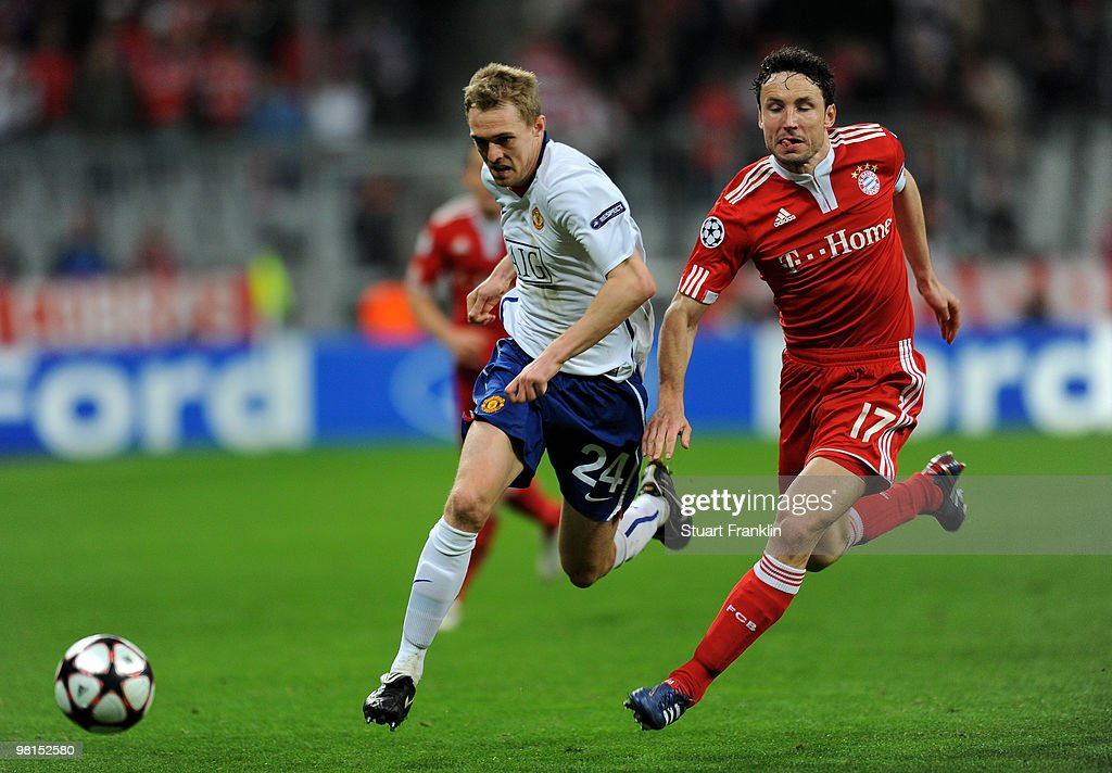 Mark Van Bommel of Bayern challenges Darren Fletcher of Manchester during the UEFA Champions League quarter final, first leg match between FC Bayern Munich and Manchester United at Allianz Arena on March 30, 2010 in Munich, Germany.