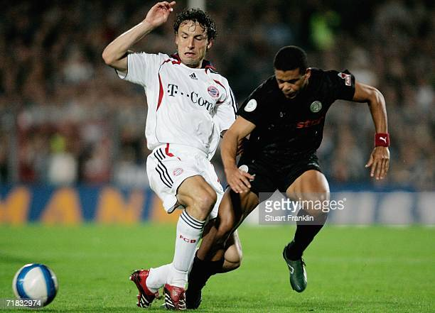 This is to correct the captions for the following photos 71793971SF003_FC_St_Pauli_v Mark Van Bommel of Bayern is challenged by Michel Mazingu of...
