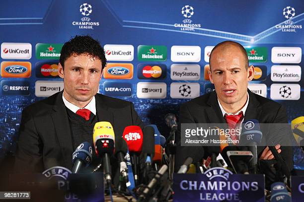 Mark van Bommel of Bayern Muenchen and Arjen Robben attend a press conference at the Marriott Worlsey Park hotel on April 6 2010 in Manchester United...