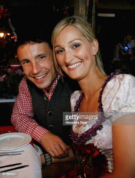 Mark van Bommel of Bayern Muenchen and his partner Andra attend the Oktoberfest beer festival at the Kaefer Wiesnschaenke tent on October 4 2009 in...