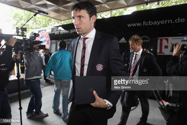 Mark van Bommel of Bayern Muenchen arrives at the Hilton hotel ahead of their Champions League first round match against FC Basel on September 27...