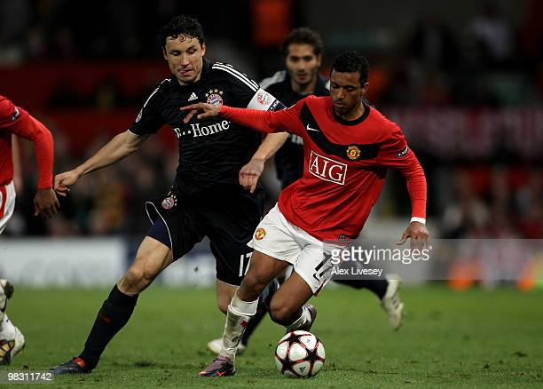 Mark van Bommel of Bayern Muenchen battles for the ball with Nani of Manchester United during the UEFA Champions League Quarter Final second leg...
