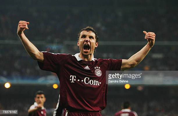 Mark van Bommel of Bayern Munich celebrates after scoring the fifth goal during the UEFA Champions League Round of 16 first leg match between Real...