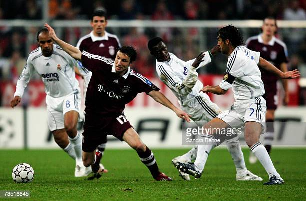 Mark van Bommel ( of Bayern Munich challenges Emerson , Mahamadou Diarra and Gonzales Raul of MAdrid during the UEFA Champions League round of...