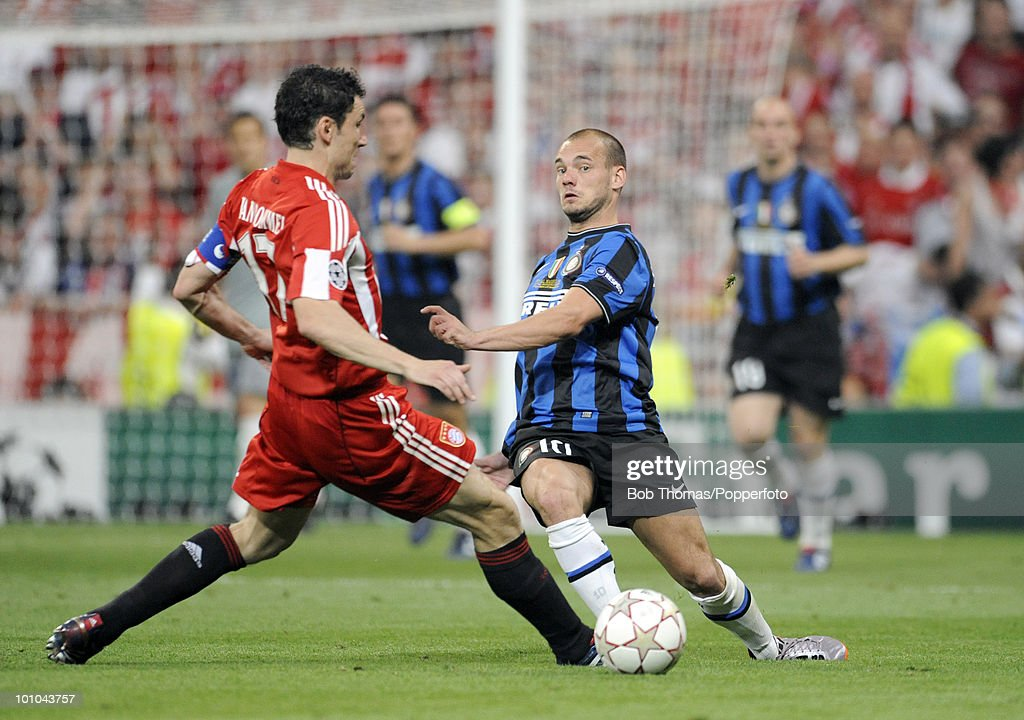 Mark van Bommel of Bayern Munich tackles Wesley Sneijder of Inter Milan during the UEFA Champions League Final match between Bayern Munich and Inter Milan at the Estadio Santiago Bernabeu on May 22, 2010 in Madrid, Spain.