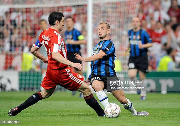 Mark van Bommel of Bayern Munich tackles Wesley Sneijder of Inter Milan during the UEFA Champions League Final match between Bayern Munich and Inter...