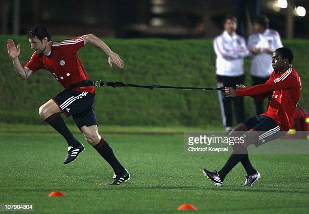 Mark van Bommel of Bayern pulls Edson Braafheid of Bayern during the FC Bayern Muenchen training session at Aspire Academy for Sports Excellence...
