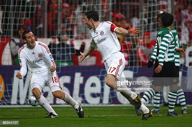 Mark van Bommel of Muenchen celebrates scoring the 6th goal with his team mate Miroslav Klose during the UEFA Champions League first knockout round...