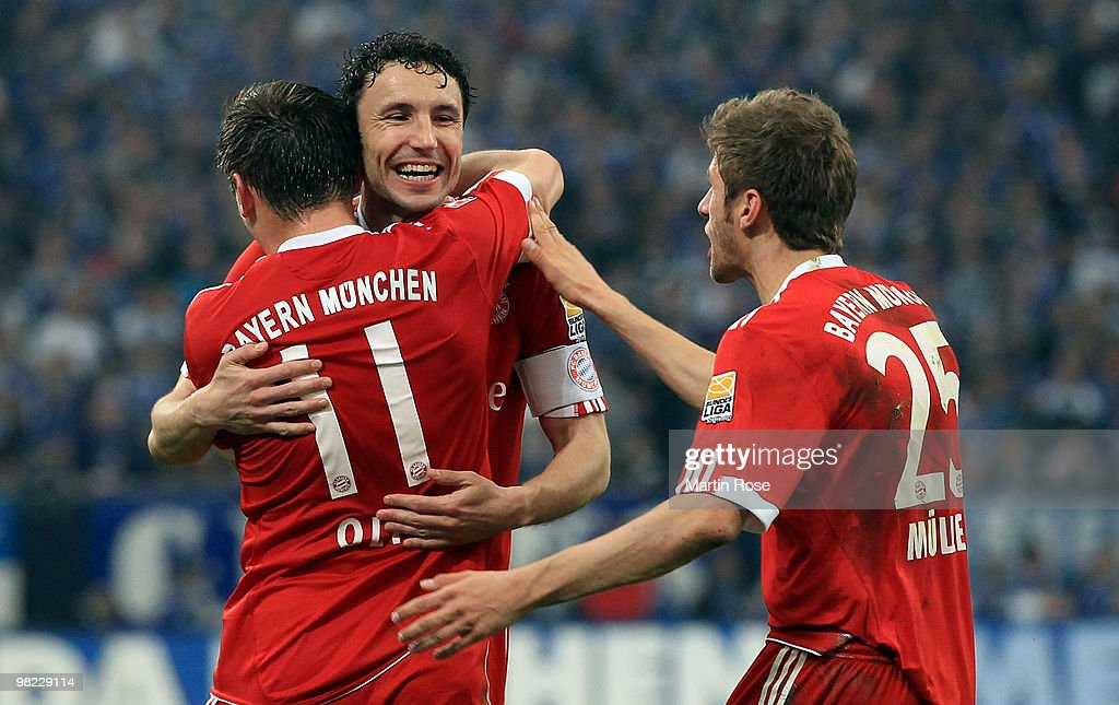 Mark van Bommel (R) of Muenchen celebrates with team mate Ivica Olic their 2nd goal during the Bundesliga match between FC Schalke 04 and FC Bayern Muenchen at the Veltins Arena April 3, 2010 in Gelsenkirchen, Germany.
