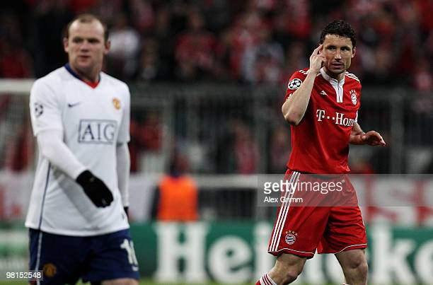 Mark van Bommel of Muenchen reacts as he walks past Wayne Rooney of Manchester during the UEFA Champions League quarter final first leg match between...
