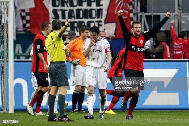 Mark van Bommel of Muenchen reacts as Marco Russ of Frankfurt celebrates during the Bundesliga match between Eintracht Frankfurt and Bayern Muenchen...