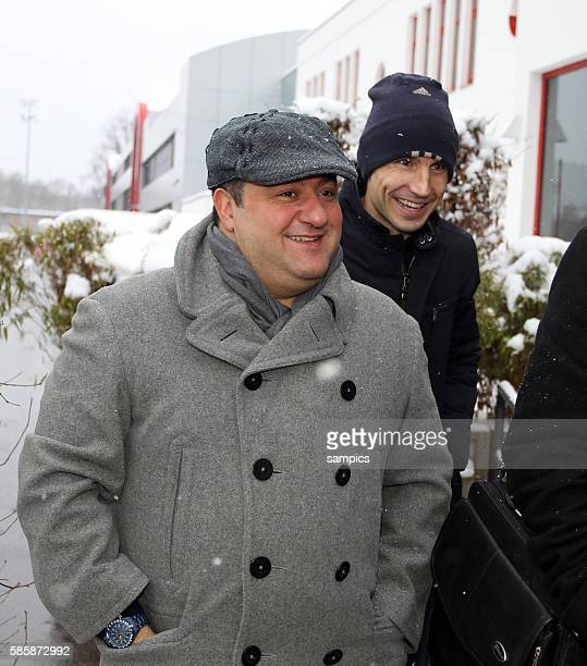 Mark van Bommel of Munich and his advisor Mino Raiola on their way to negotiations with the Bayern MUnich executives in Munich Germany