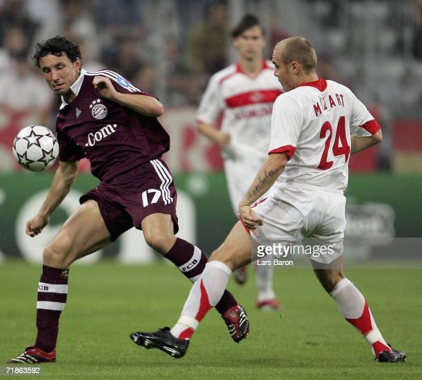 Mark van Bommel of Munich challenges Mozart of Moscow for the ball during the UEFA Champions League Group B match between Bayern Munich and Spartak...