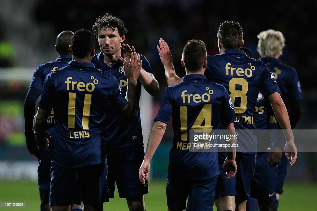 Mark Van Bommel (C) of PSV along with team mates congratulate Jeremain Lens (#11) for scoring the third goal of the game during the Eredivisie match between AZ Alkmaar and PSV Eindhoven at the AFAS Stadium on April 20, 2013 in Alkmaar, Netherlands.