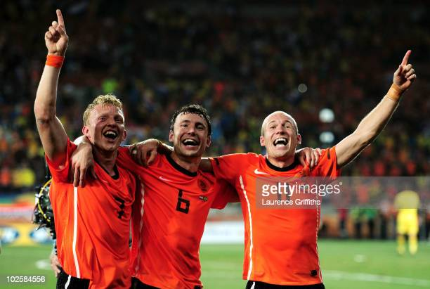 Mark Van Bommel of the Netherlands celebrates victory with Dirk Kuyt and Arjen Robben following the 2010 FIFA World Cup South Africa Quarter Final...