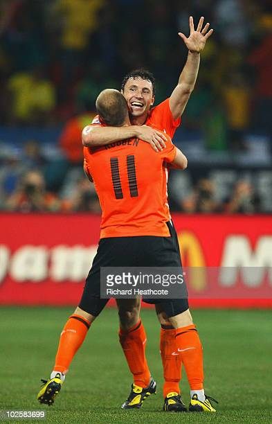 Mark Van Bommel of the Netherlands celebrates with team mate Arjen Robben after victory and progress to the semifinals during the 2010 FIFA World Cup...