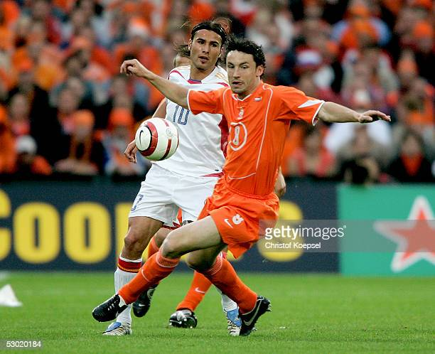 MArk van Bommel of the Netherrlands is tackled by Adrian Mutu of Romania during the World Cup qualification match between Netherlands and Romania on...