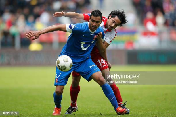 Mark van der Maarel of Utrecht and Nacer Chadli of Twente battle for the ball during the Eredivisie Europa League Play off match between FC Utrecht...