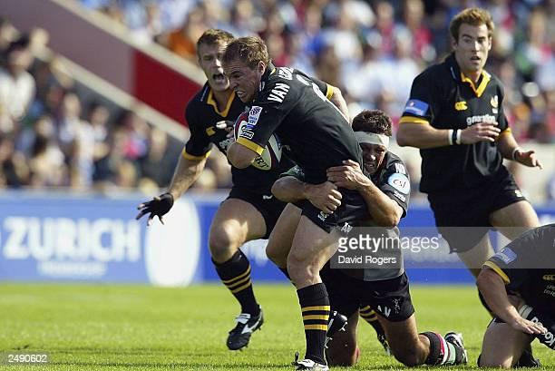 Mark van Gisbergen of Wasps is tackled by Andre Vos of Harlequins during the Zurich Premiership match between Harlequins and Wasps at the Stoop...