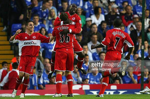 Mark Viduka is congratulated by Jimmy Floyd Hasselbank after scoring for Middlesbrough during the Barclays Premiership match between Birmingham City...