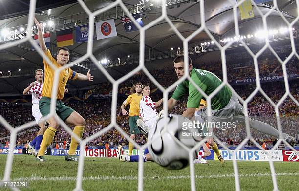 Mark Viduka of Australia celebrates after teammate Harry Kewell scores his team's second goal to level the scores at 22 during the FIFA World Cup...