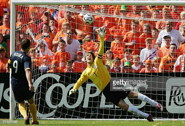 Mark Viduka of Australia misses his penalty kick as Edwin van der Sar of Netherlands dives to save during the international friendly match between...