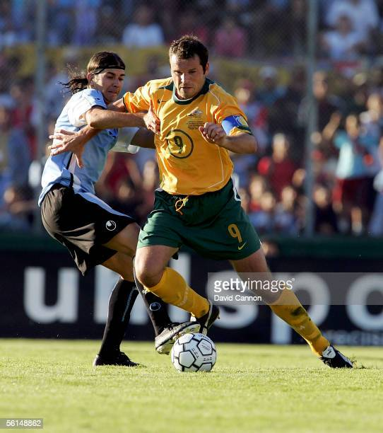 Mark Viduka of Australia powers away from Alvaro Recoba of Uruguay during the FIFA World Cup 1st Leg playoff match between Uruguay and Australia at...