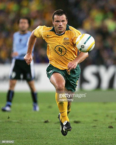 Mark Viduka of Australia races after the ball during the second leg of the 2006 FIFA World Cup qualifying match between Australia and Uruguay at...