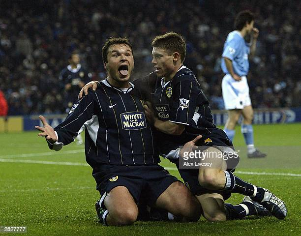 Mark Viduka of Leeds United celebrates scoring a goal with James Milner during the FA Barclaycard Premiership match between Manchester City and Leeds...