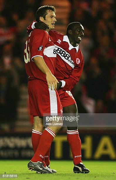 Mark Viduka of Middlesbrough celebrates his second goal with Jimmy Floyd Hasselbaink during the UEFA Cup first round, first leg match between...