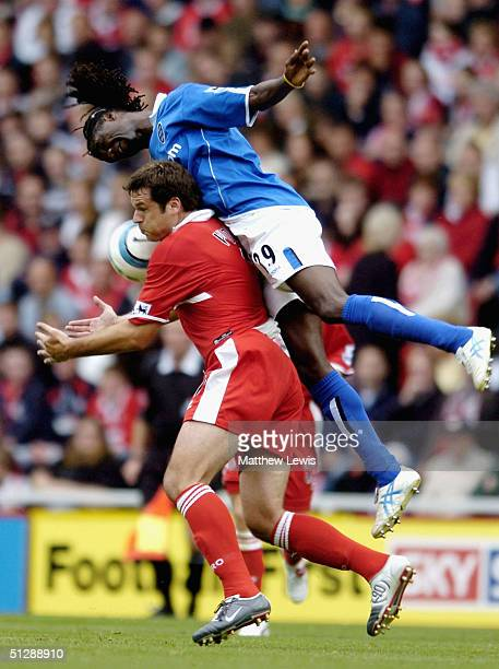 Mark Viduka of Middlesbrough is put under pressure by Mario Melchiot of Birmingham during the Barclays Premiership match between Middlesbrough and...