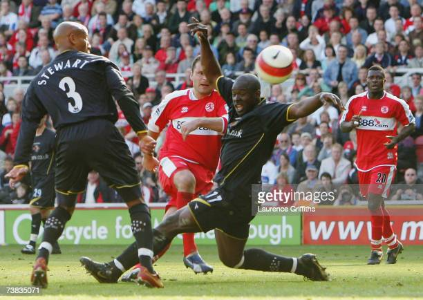 Mark Viduka of Middlesbrough scores the third goal under pressure from Danny Shittu of Watford during the Barclays Premiership match between...