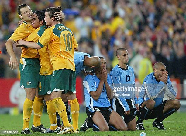 Mark Viduka Tim Cahill and Harry Kewell of the Socceroos celebrate victory after the second leg of the 2006 FIFA World Cup qualifying match between...