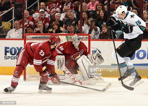 Mark Visentin of the Phoenix Coyotes gets ready to make a save as James Sheppard of the San Jose Sharks jumps out of the way of the shot at Jobingcom...