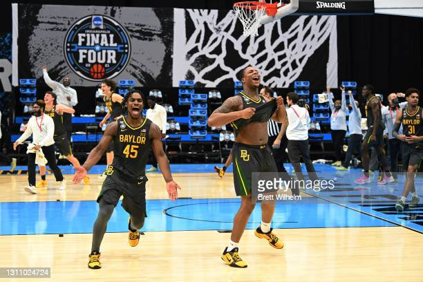 Mark Vital and Davion Mitchell of the Baylor Bears celebrate after defeating the Gonzaga Bulldogs in the National Championship game of the 2021 NCAA...