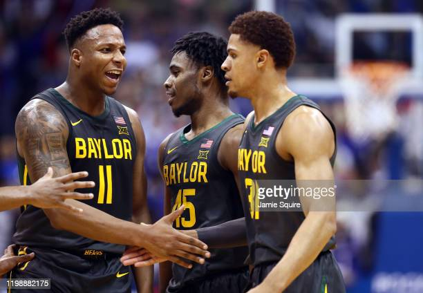 Mark Vital and Davion Mitchell of the Baylor Bears congratulate MaCio Teague after a basket during the game against the Kansas Jayhawks at Allen...
