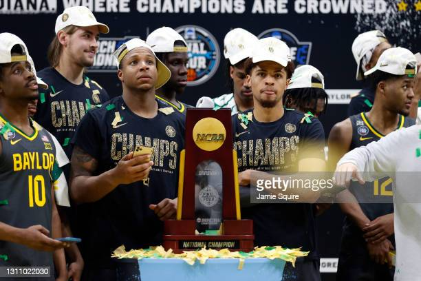 Mark Vital and MaCio Teague of the Baylor Bears look on with the trophy after defeating the Gonzaga Bulldogs 86-70 in the National Championship game...