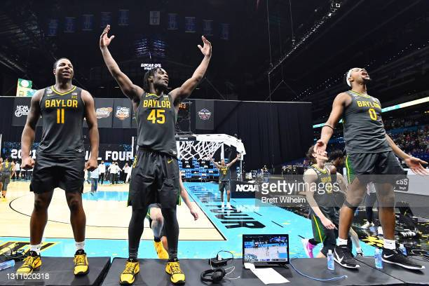 Mark Vital, Davion Mitchell, and Flo Thamba of the Baylor Bears celebrate after defeating the Gonzaga Bulldogs in the National Championship game of...