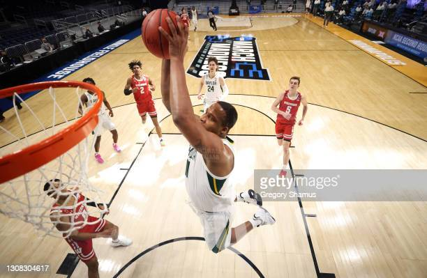 Mark Vital of the Baylor Bears goes up for a dunk during the first half against the Wisconsin Badgers in the second round game of the 2021 NCAA Men's...