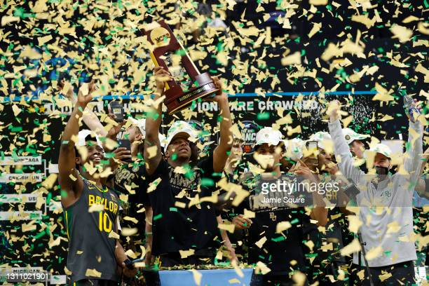 Mark Vital of the Baylor Bears holds up the trophy after defeating the Gonzaga Bulldogs 86-70 in the National Championship game of the 2021 NCAA...