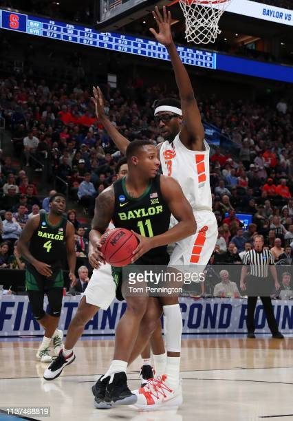 Mark Vital of the Baylor Bears looks to pass against Paschal Chukwu of the Syracuse Orange during the first half in the first round of the 2019 NCAA...