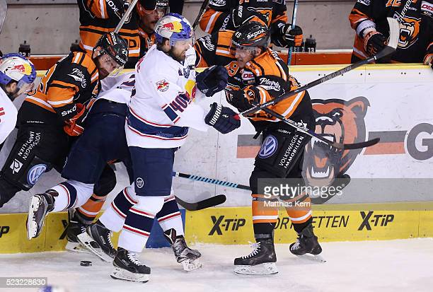 Mark Voakes of Wolfsburg is attackt by Daniel Sparre of Muenchen during the DEL playoffs final game four between Grizzlys Wolfsburg and Red Bull...