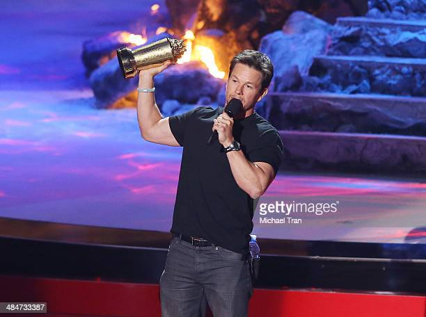 Mark Wahlberg accepts the MTV Generation Award onstage during the 2014 MTV Movie Awards held at Nokia Theatre LA Live on April 13 2014 in Los Angeles...