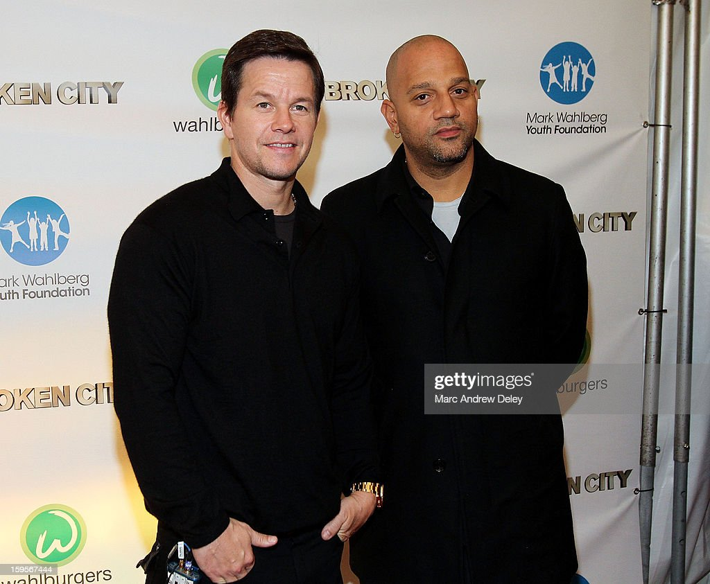 Mark Wahlberg and Director Allen Hughes attend the screening of 'Broken City' hosted by Mark Wahlberg at Patriot Cinemas on January 15, 2013 in Hingham, Massachusetts.