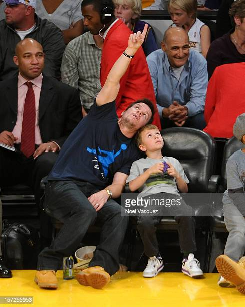 Mark Wahlberg and his son Michael Robert Wahlberg attend a basketball game between the Denver Nuggets and the Los Angeles Lakers at Staples Center on...