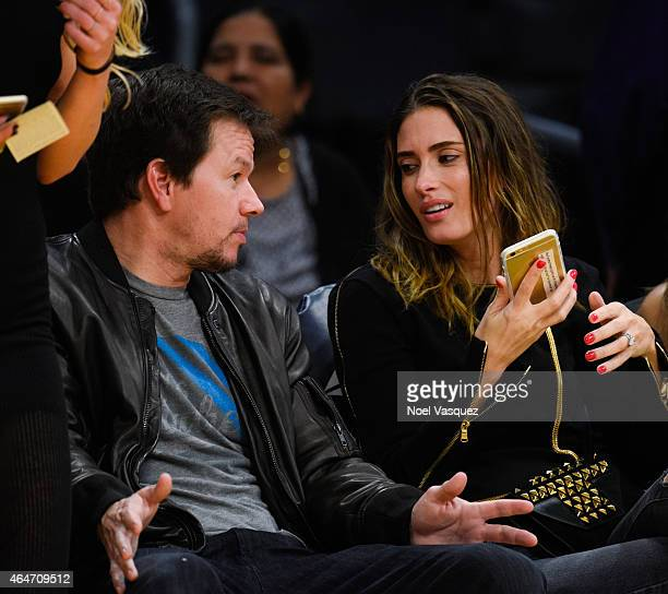 Mark Wahlberg and his wife Rhea Durham attend a basketball game between the Milwaukee Bucks and the Los Angeles Lakers at Staples Center on February...