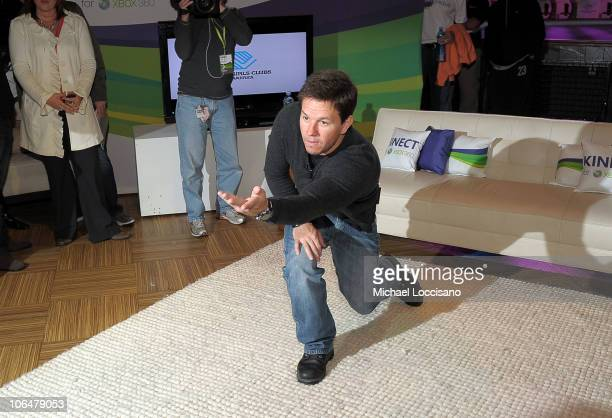 Mark Wahlberg playing Kinect Sports at the Kinect For Xbox 360 Launch with Boys Girls Club of America in Times Square on November 3 2010 in New York...